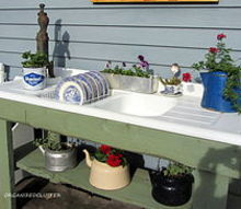 a whimsical outdoor kitchen, flowers, gardening, outdoor living, Vintage tea kettles are planted with annuals on the bottom shelf and on the right side drainer
