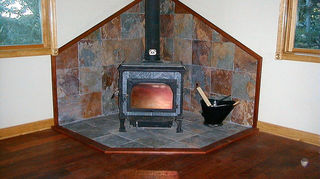 removing a wood burning stove, concrete masonry, living room ideas, Soapstone stove with slate background