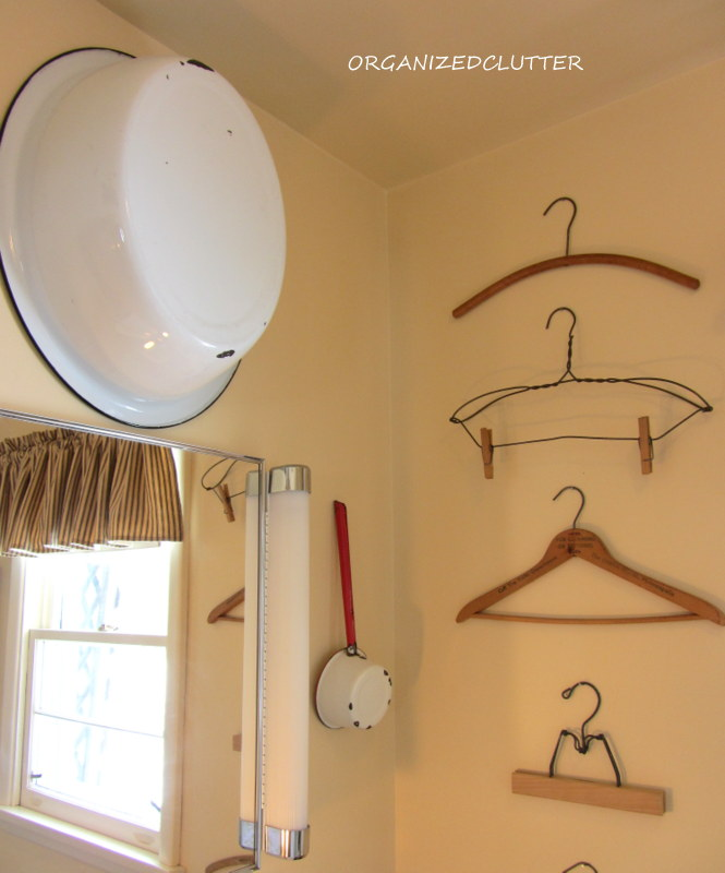 There's something about a grouping of almost anything that makes an impact.  Here is a column of vintage hangers.