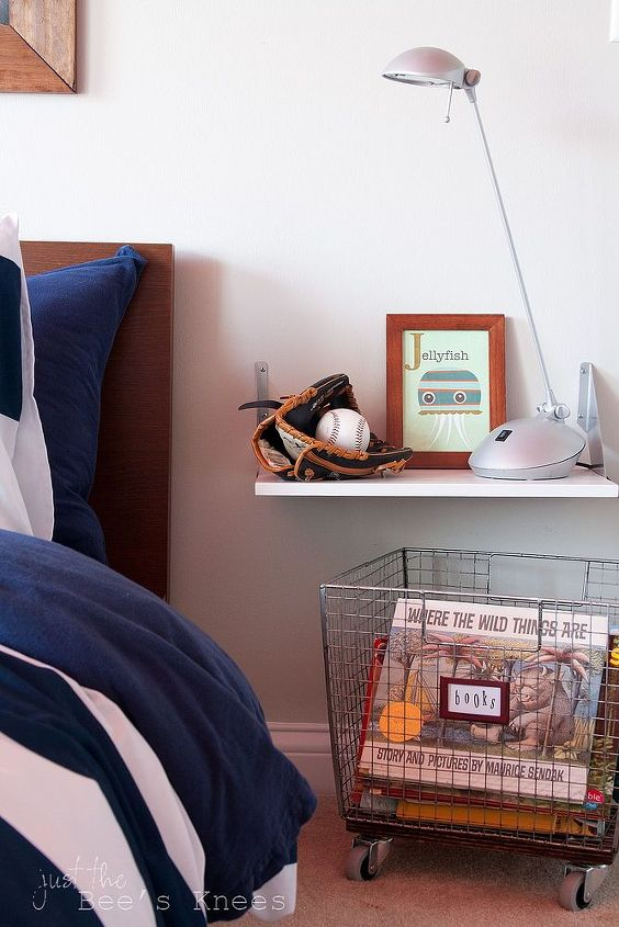 A shelf turned nightstand and  DIY rolling wire basket is the perfect substitution for a bedside table.