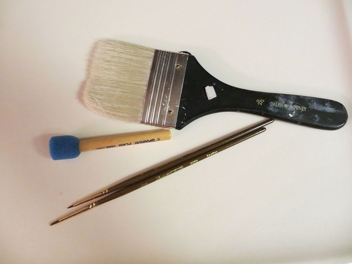 Brushes.. large one to paint the brick,  small one's for some of the print and the sponge was very handy with the stencils also..