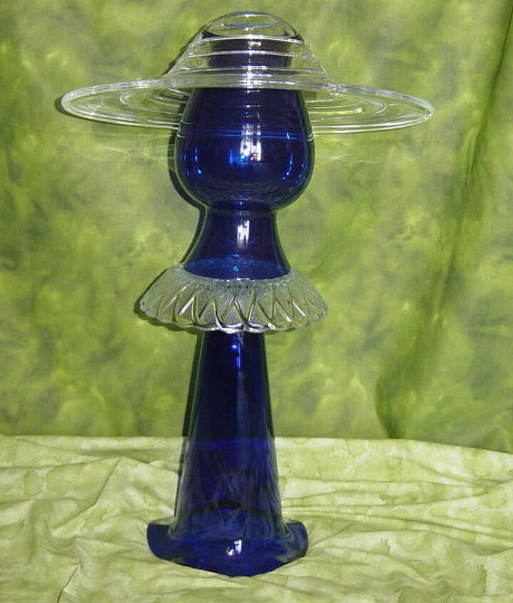 Sophisticated Lady-in-Blue.   Her picture-hat is a heavy bowl with raised spiral swirls. She is ready for the opera...maybe the gentleman in white will be her escort!  Glass redefined and assembled by Nita Hooper.