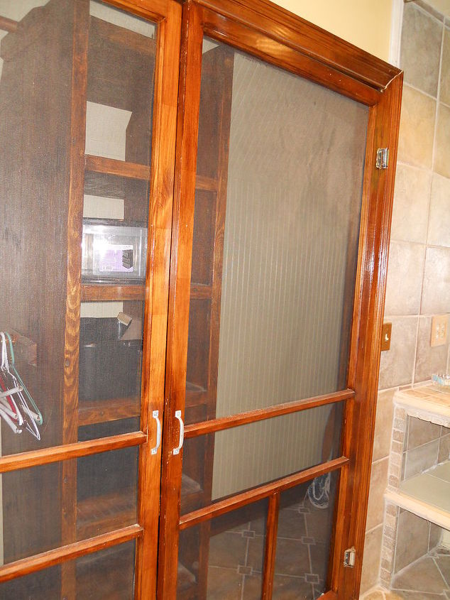 this is a cool idea screen doors on a closet in a bathroom, home decor, painted furniture