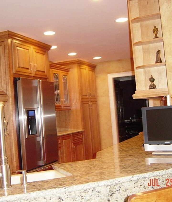 The South wall vie from the breakfast bar showing the refrigerator to the pantry