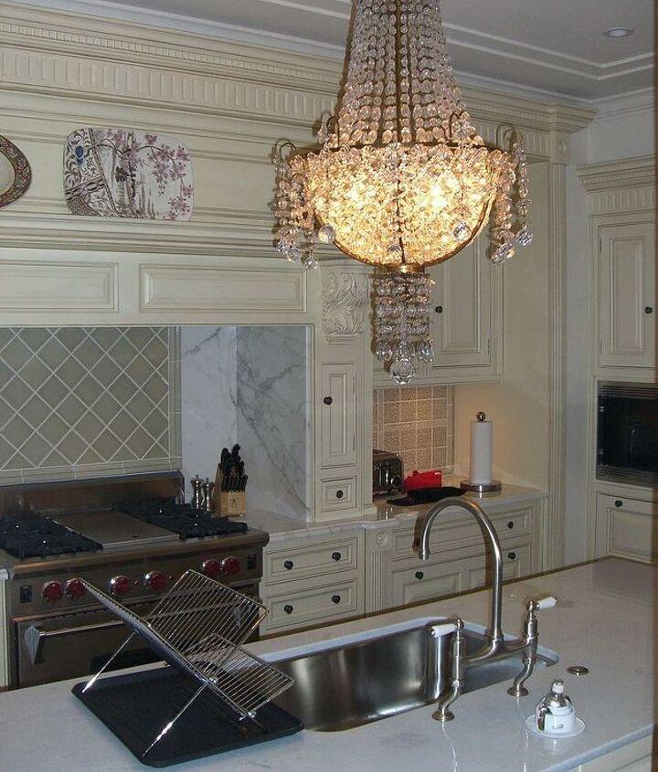 kitchen island with antique chandelier custom cabinets