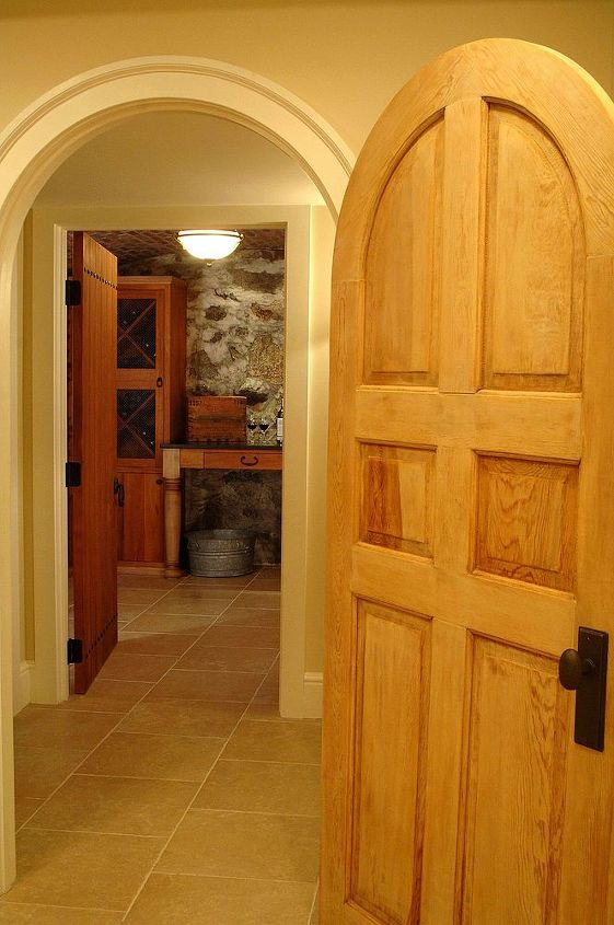 Custom doors and wine cellar built by Titus Built, LLC