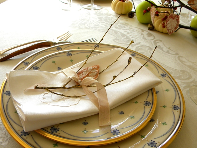 Use twigs and painted fabric leaves to dress up each place setting.