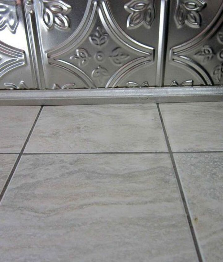 It was time to get rid of the 80's green laminate.  Did you know that you can tile over laminate? Well, you can.  All you do is sand to rough up the surface.  This allows the tile adhesive to adhere better to create a stronger bond.