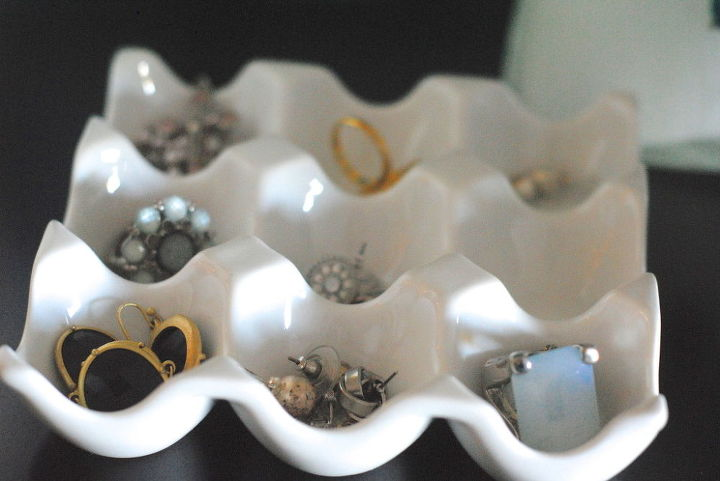 This ceramic egg dish in white is a perfect place for rings and earrings.