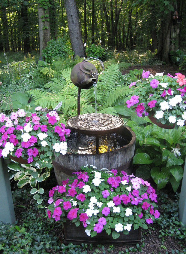 teapot shade garden fountain, gardening, repurposing upcycling, This is my teapot fountain this year I try and change it a little year