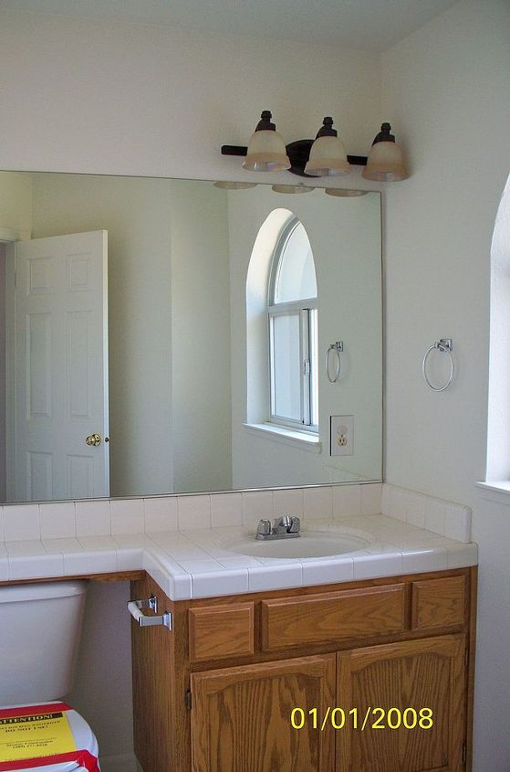Moved into a new house 2 years ago and was overwhelmed with the 'tract home' blues. A prime example of a 'before'. Generic 'contractor grade' cabinets in honey oak in the downstairs bath.