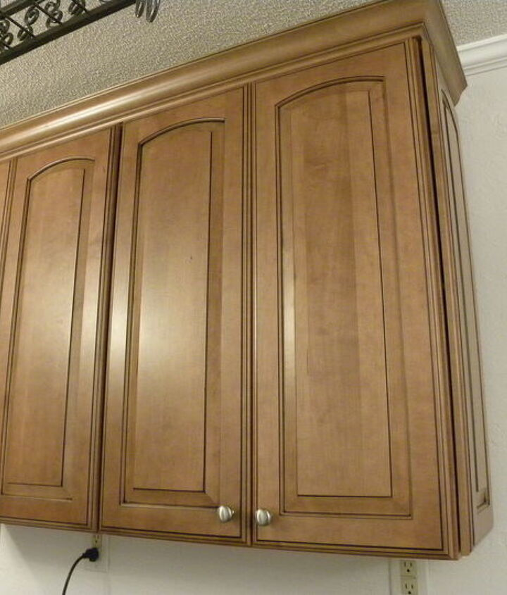 Upper cabinets to the right of the window