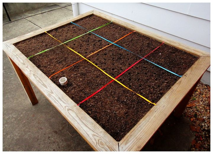 Now that we have the Garden Stamp, we are setting aside the yardstick and extra ribbon to focus on planting square foot patterns of edible color.