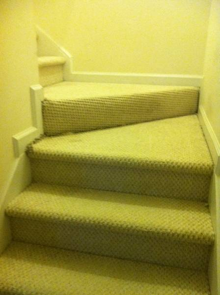 Carpeted staircase landings.