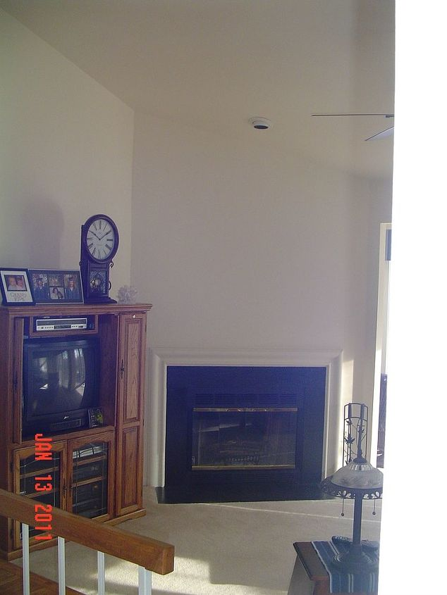 q suggestions for a huge wall from vaulted ceiling to lower level, home decor, home improvement, home maintenance repairs, how to, wall decor, Corner fireplace across from large main wall TV and cabinet are no longer there Would also like to have more of a mantel to make the fireplace really stand out