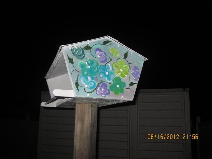 my pots, flowers, gardening, painting, Other side to feeder hubby built and I painted