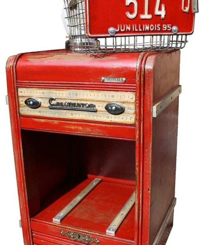 An old refrigerator badge and utility valve handles dress up the front on top of large measuring sticks.  Other measuring sticks wrap the sides to resemble old steamer trunks and a couple more run along the floor of the interior floor.