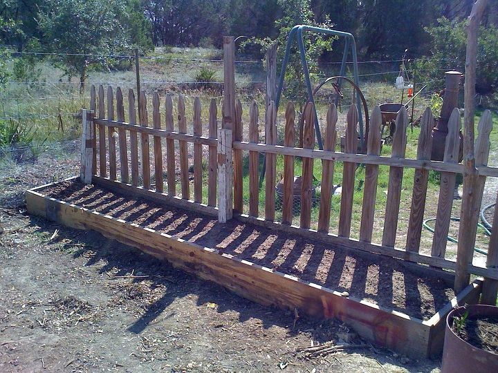 Beds under construction.  This has bulbs and flower seeds.  Recycled fence - see before pictures below.