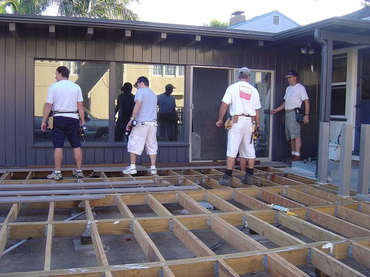 More men getting ready to lay the decking.