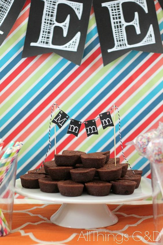 "I used Michael's miniature chalkboard pennants to make this ""Mmmm"" banner for the brownie bites."