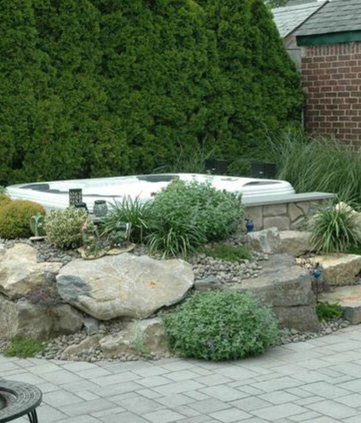 Hot Tub Surround: Even an aboveground portable spa can be made to appear in-ground by careful landscaping