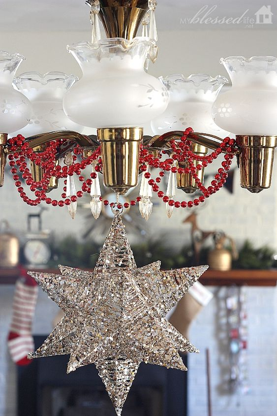 I strung a few blingy red beads on the chandelier and I hung up this lovely Moravian star.