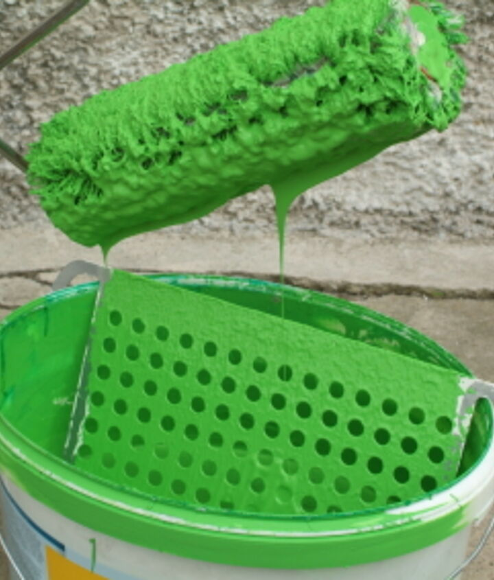 Dunk that roller.  When using alot of paint, a 5 gallon bucket works better than a roller pan. Photo ©iStockphoto.com