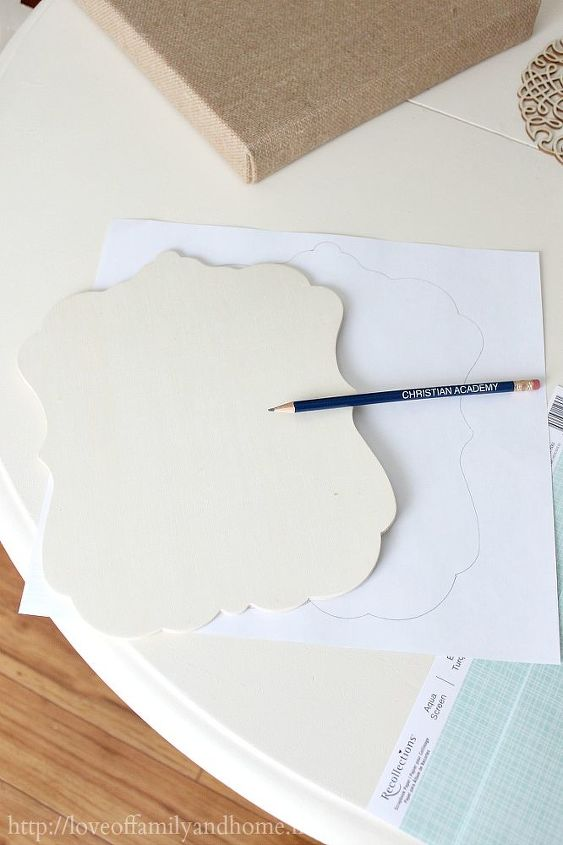 Trace the wooden plaque onto the scrapbook paper & cut out.