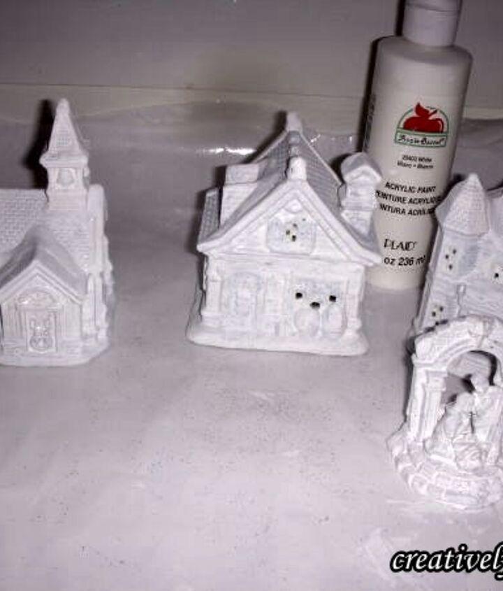 Base coat the houses with white acrylic paint