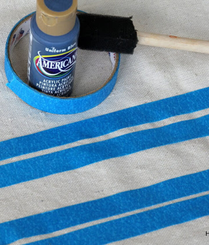 I used painter's dropcloth, taped off stripe areas and painted with craft paint to give it the faux grain sack look.