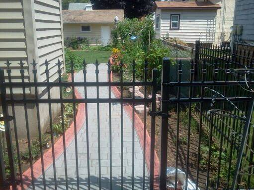 I had an iron fence and gate installed so that people walking by my home can view the side yard.