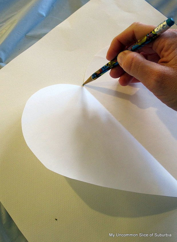 Start off by tracing a heart on some heavy weight card-stock .  If you are going to be placing the heart in a frame, make sure the paper is cut to the correct size.