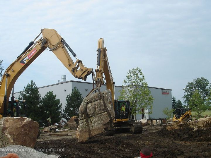 This Pond Boulder took two machines to move it and they were struggling!