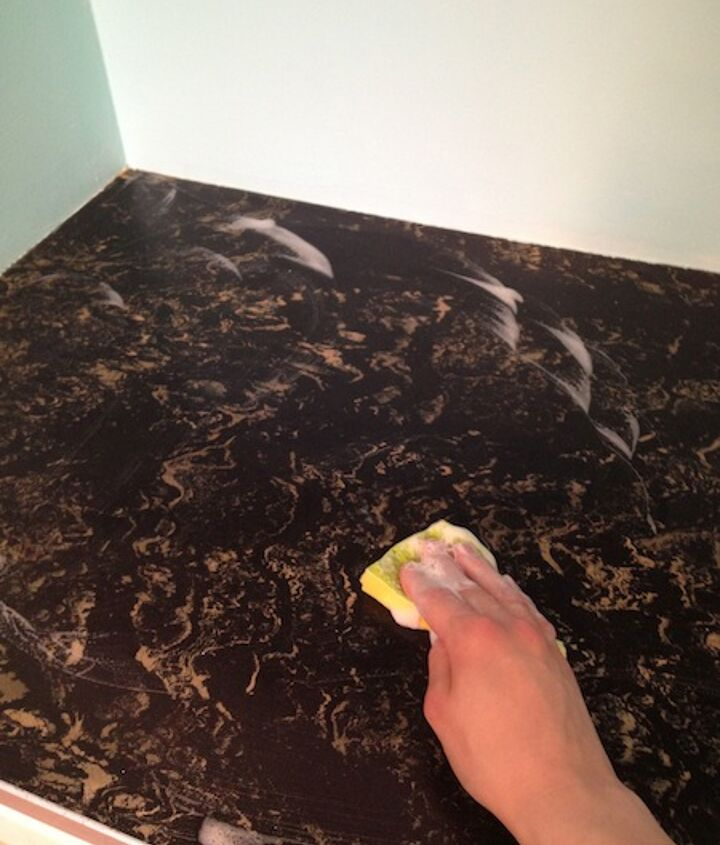 diy countertop revival, countertops, diy, kitchen design, The first step is to wipe down your counter with soap and water and allow it to dry This is really important because the contact paper sticks better to clean surfaces