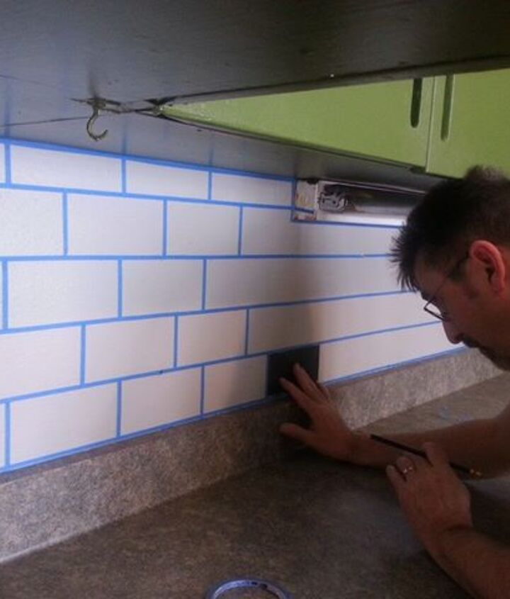 "measuring and taping off the ""grout""; paint each ""tile"" whatever color you would like.  We did a pattern."