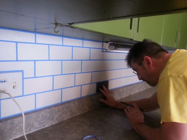 painted subway tile backsplash, kitchen backsplash, kitchen design, painting, tiling, measuring and taping off the grout paint each tile whatever color you would like We did a pattern