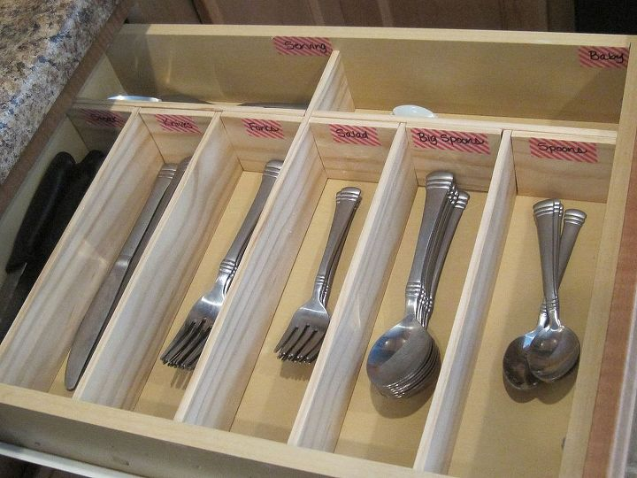 We DIYed a custom drawer for our utensils.  This holds so much more than the shallow store bought organizer.