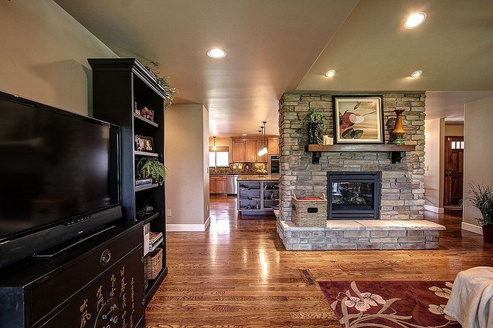 CapStone Home Renovations Parker, CO. Home, kitchen, and fireplace remodel with hardwood floors, smooth finish walls, double sided gas fireplace, ledge stone, knotty alder cabinets, granite countertops, new lighting package and slate mosaic tile. Doane Designs. Andy Gould Photography