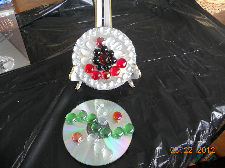 q my newest jewelry or candy or whatever tier and cd hangers, crafts, cd s hang out on my tree