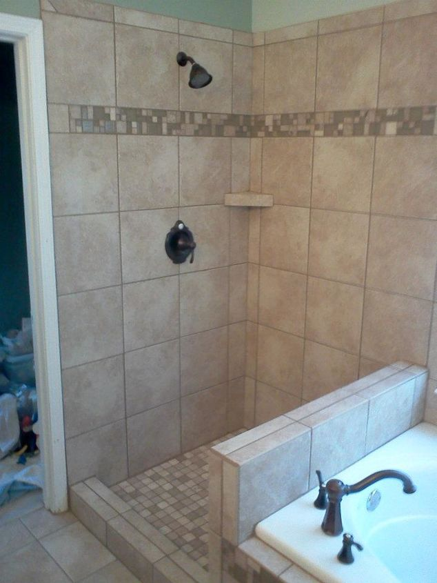 Nice tile with a good accent strip was chosen by the customer