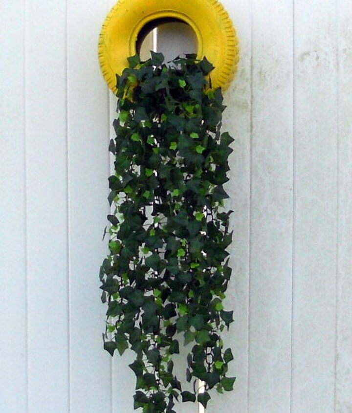 Tire planter mounted to deck wall