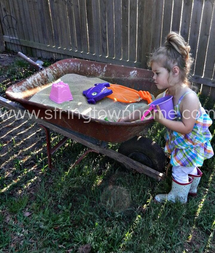 sandbox out of a wheelbarrow, outdoor living, repurposing upcycling
