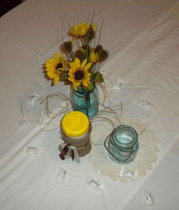 Tablescape detail:  mason jars & flowers, tealights, with vintage doilies, twine and scattered mints; burlap-covered Wet Ones for wings buffet