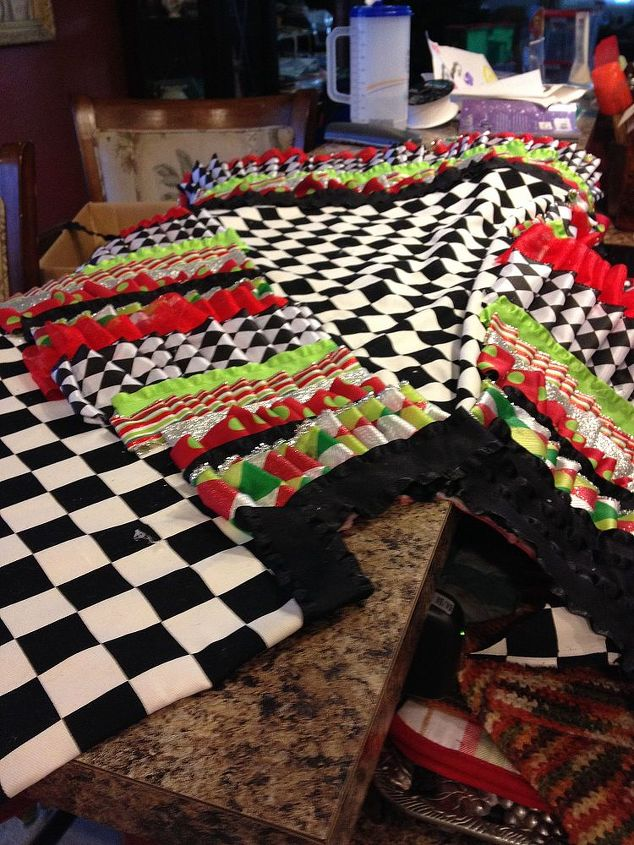 I made several rows of continuous ribbon layers at the bottom until I covered about an inch or two over the fabric.  Then I went up in smaller rows between the fabric pie shapes.  I ended with the solid color.
