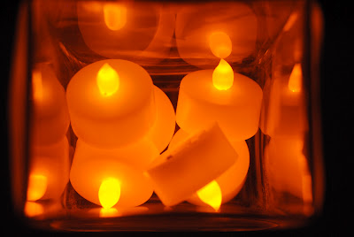 Turn on electric tealights and place inside vase.