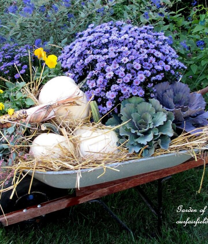 Old wheelbarrow filled with hay, ornamental cabbage, fall asters, sedum, white pumpkins and pansies makes a nice Fall display!http://pinterest.com/barbrosen/