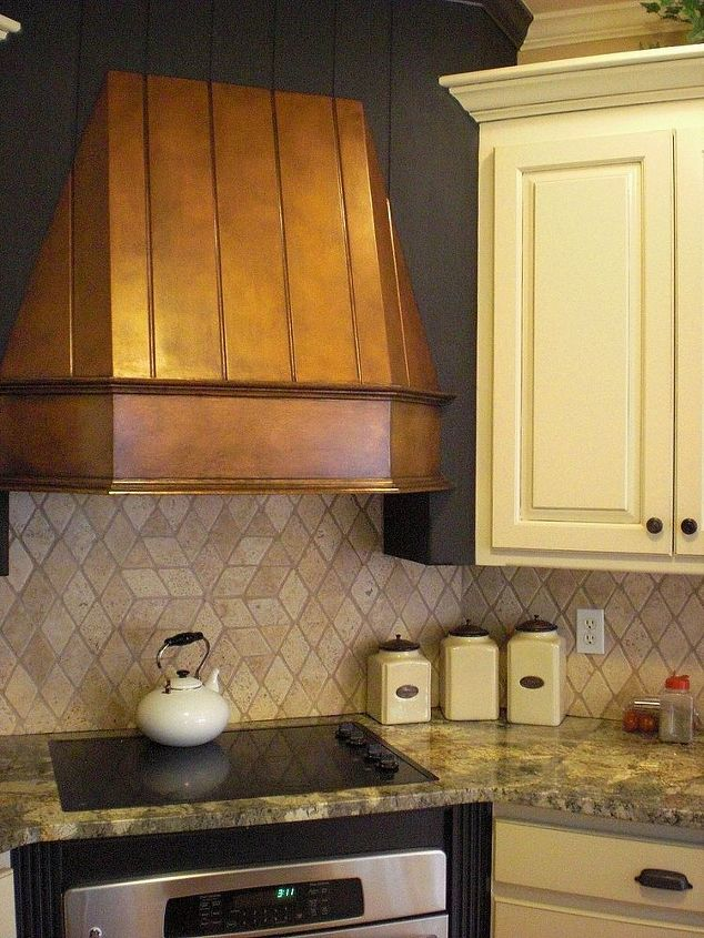 stove hood transformation, appliances, home decor, kitchen design, After with faux finish and paint I also painted cabinetry and detailed the crevices to add warmth
