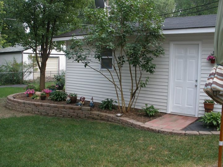 trellis art project, curb appeal, gardening, This is what we started with The bush was ugly and had to go