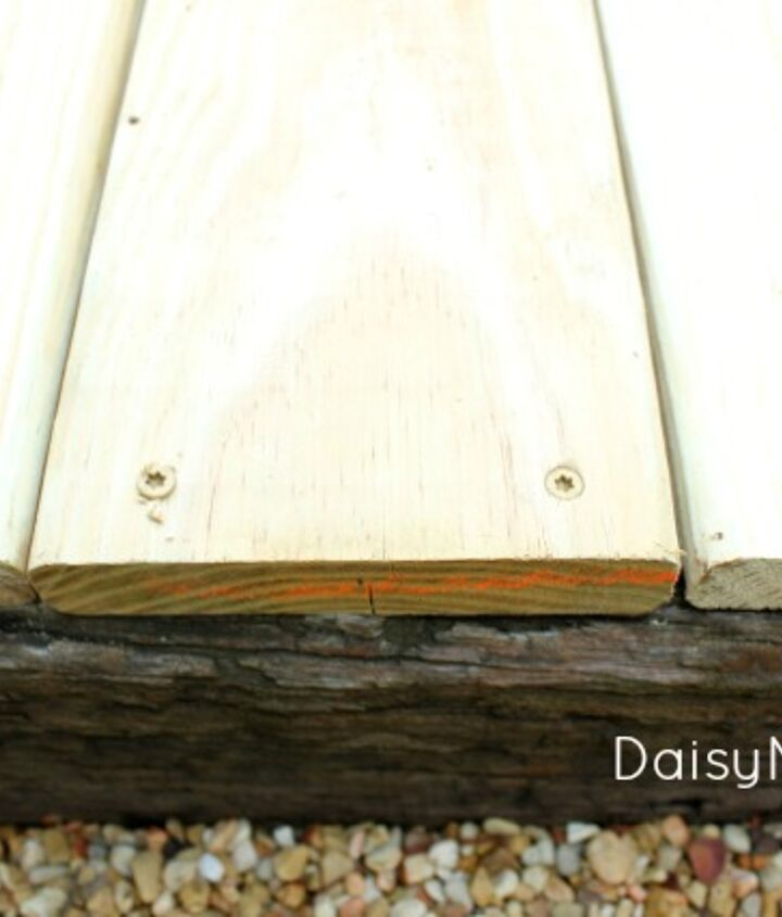 I screwed the decking boards into the railroad ties on each side.