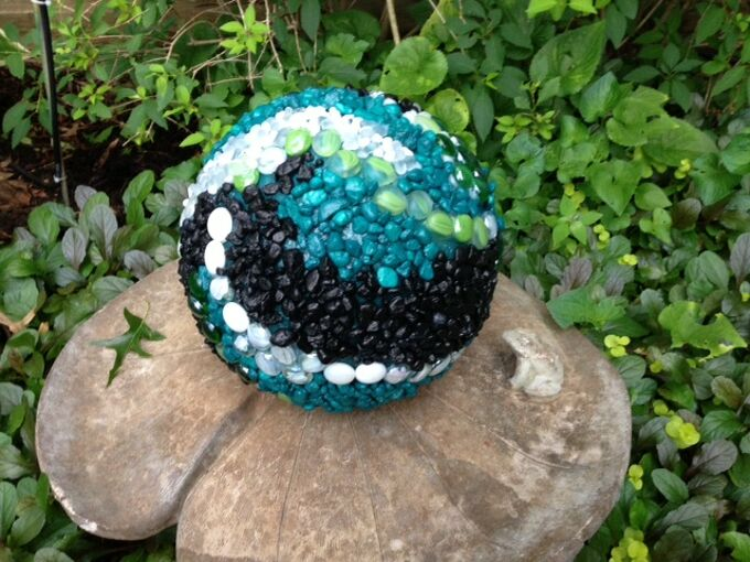 what to do with old bowling balls, crafts, outdoor living, repurposing upcycling, Here it is in the garden